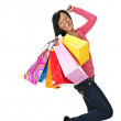 Young excited black woman with shopping bags — Stock Photo