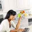 Woman shopping online at home - Stok fotoğraf