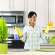 图库照片: Young womcleaning kitchen