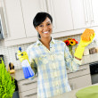 Young woman cleaning kitchen — Stock Photo #6650993