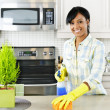 Young woman cleaning kitchen — Foto de Stock