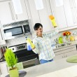 Young woman cleaning kitchen — Stock Photo