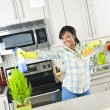 Foto Stock: Young woman cleaning kitchen