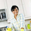 Young woman cleaning kitchen — Stock Photo #6651078