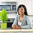 Young woman in kitchen — Foto de Stock