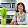 Young woman in kitchen — Stock Photo