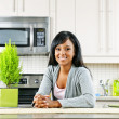 Young woman in kitchen — Stock Photo #6651189