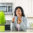Woman in kitchen with coffee cup — Stock Photo #6651252