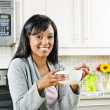 Woman having breakfast — Stock Photo