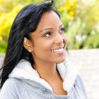 Stock Photo: Portrait of smiling young woman outdoors