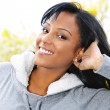 Portrait of smiling young woman outdoors — Stock Photo #6651459