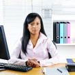 Royalty-Free Stock Photo: Black businesswoman at desk