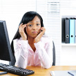 Worried black businesswoman at desk — Stock Photo #6651605