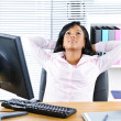 Black businesswoman resting at desk — Stock Photo #6651633