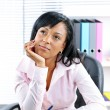 Black businesswoman at desk in office - Stock Photo