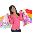 Happy young black woman with shopping bags — Stock Photo #6651808