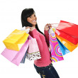 Happy young black woman with shopping bags — Stock Photo