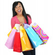 Excited young black woman with shopping bags — Stock Photo