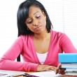 Unhappy female student studying — Stockfoto