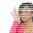 Woman looking through venetian blinds — Stock Photo #6651853