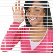 Smiling woman looking through blinds — Stock Photo #6651860