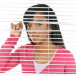 Woman looking through venetian blinds — Stock Photo #6651866