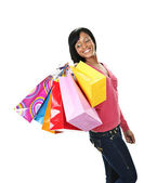 Young smiling black woman with shopping bags — Stock Photo