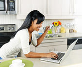 Woman shopping online at home — Stock Photo