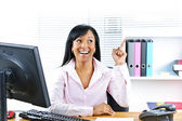 Businesswoman having idea at desk — Stock Photo