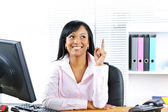 Businesswoman having idea at desk — Stok fotoğraf
