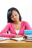 Unhappy female student studying — Stock Photo