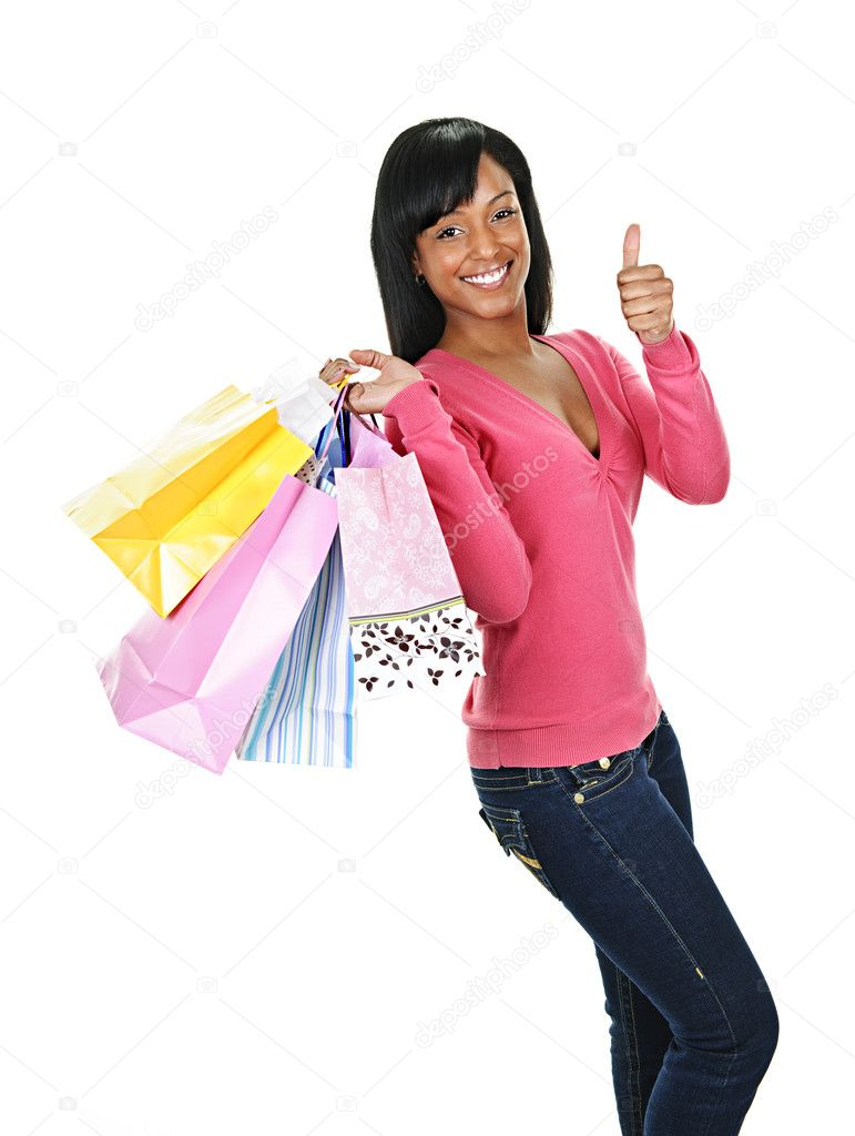 Young smiling black woman with shopping bags giving thumbs up — Stock Photo #6651805