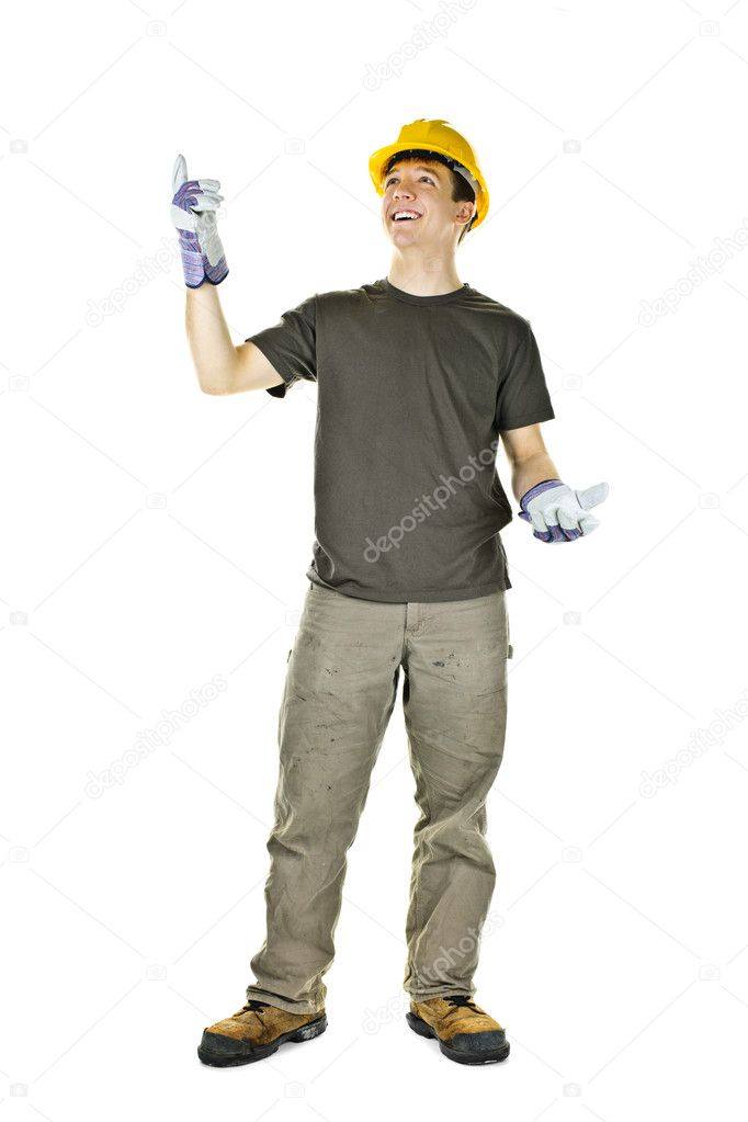 Smiling construction worker pointing up standing isolated on white background — Stock Photo #6652226