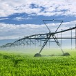 Irrigation equipment on farm field - Stockfoto