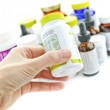 Hand holding medicine bottle — Stock Photo #6696498