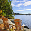 Adirondack chairs at lake shore — Stock Photo #6696680