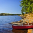 Canoe on shore — Stock Photo