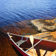 Stock Photo: Canoe on shore