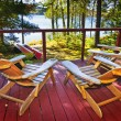 Forest cottage deck and chairs - Foto Stock
