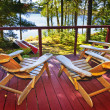 Forest cottage deck and chairs — Stock Photo #6696715