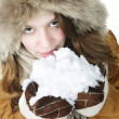 Playful winter girl holding snow — Stock Photo #6697136