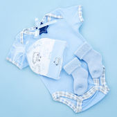 Blue baby clothes for infant boy — Stock Photo