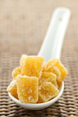 Candied ginger pieces in spoon — Stock Photo
