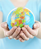 Hands holding globe — Stock Photo