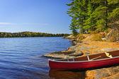 Canoe on shore — Stock Photo