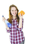 Smiling girl with cleaning supplies — Stock Photo