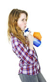 Young woman with cleaning supplies — Stock Photo