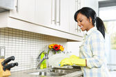 Young woman washing dishes — Stock Photo