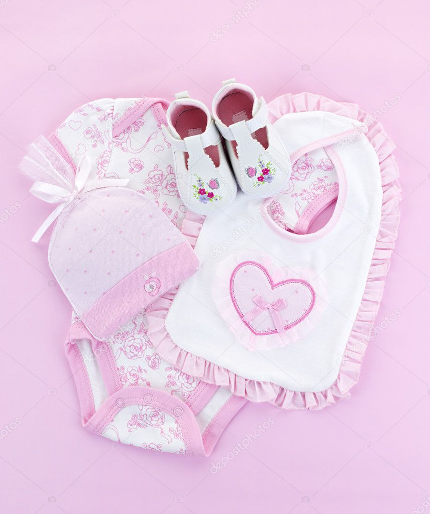 Pink baby clothes for infant girl stock image