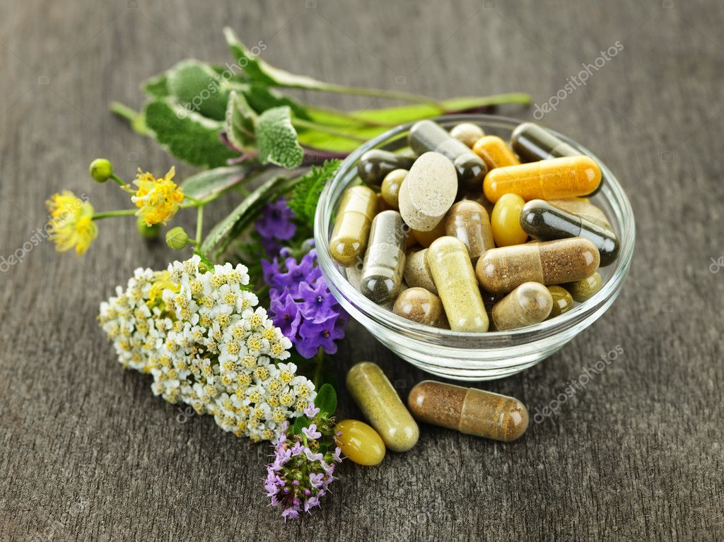 Herbs with alternative medicine herbal supplements and pills — Stock Photo #6696647
